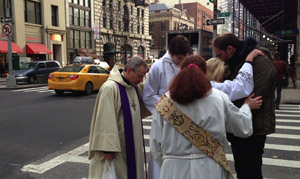 Praying on Ash Wednesday at 18th and Park Ave South